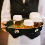 A server holding freshly tapped beer at Restaurant Lokál in Prague