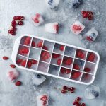 Frozen coconut water and berry cubes