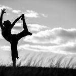 Bridget Lyons performs various yoga poses in view of the Tetons, Idaho