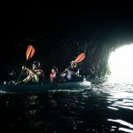 A blind adventurer leads his kayak into a sea cave on Santa Cruz Island off the coast of Santa Barbara.
