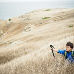 A young boy hiking on Santa Cruz Island in the Channel Islands off Santa Barbara, CA.
